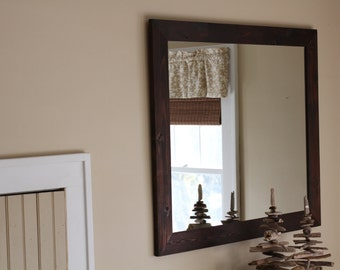 mirror framed in reclaimed cedar
