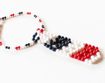 1970s tie necklace red white and blue choker plastic beaded Hong Kong