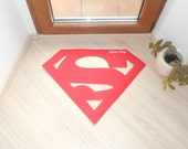 Floor mat made with a Superman logo. Sign doormat.