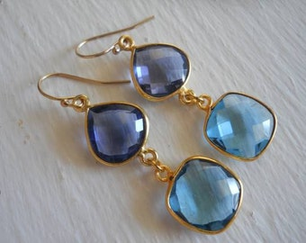 Bezel set quartz gemstone earrings in gold they dangle from 14kt gold filled ear wires. THESE ARE AMAZING. London Blue and Iolite