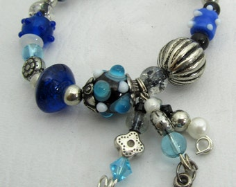 Blue Lampwork Beaded Stretch Bracelet - Dangles with Sun Charm
