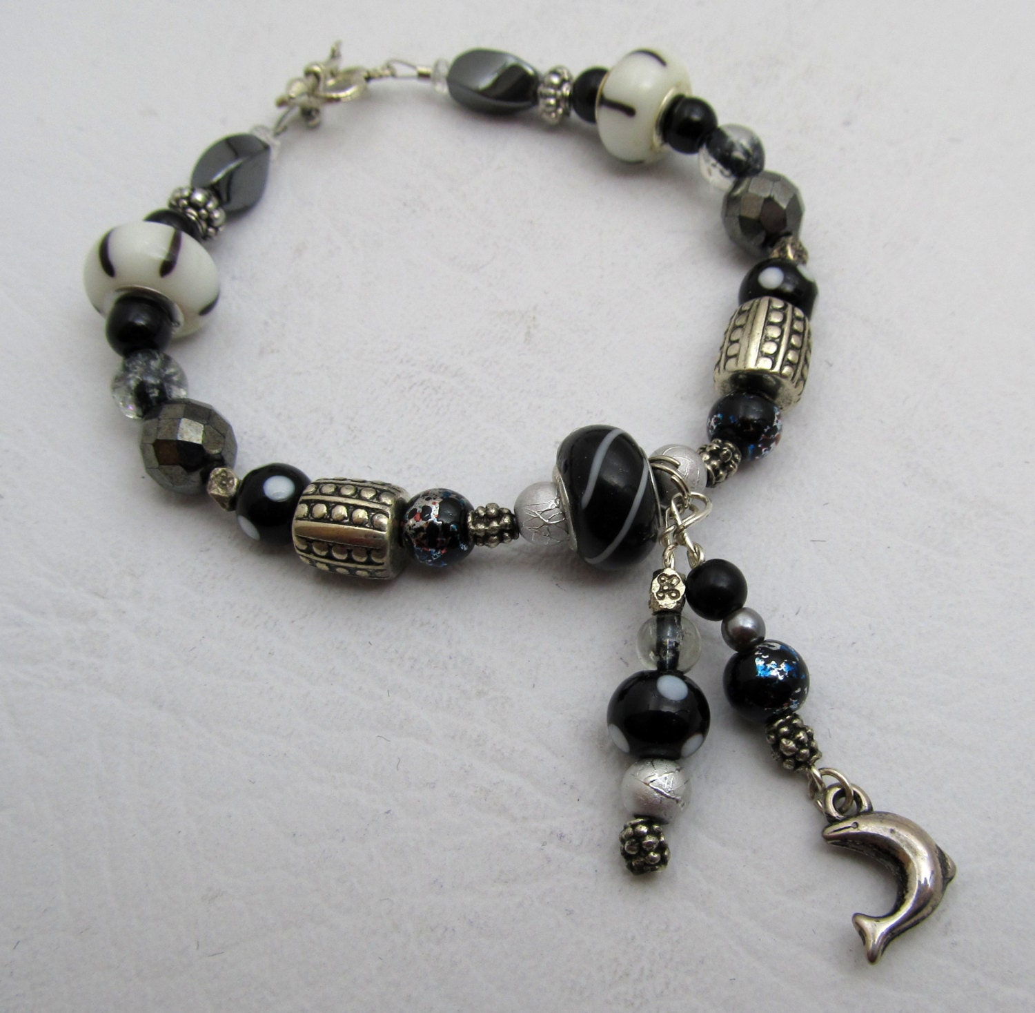 Dolphin Charm Bracelet: Black & White Beaded Dangle Charm Bracelet Dolphin Lampwork