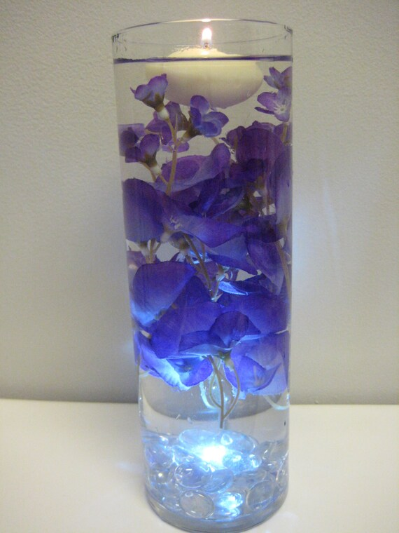 Unavailable listing on etsy for How to make flowers float in vases