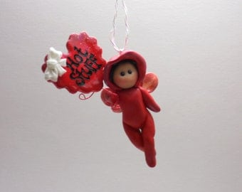 "Valentine's Day cupid in red polymer clay ""Hot Stuff"" ornament"