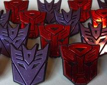 24 TRANSFORMERS logo shield cupcake rings picks or cake toppers, great for your next robot boy birthday party or as treat bag favors