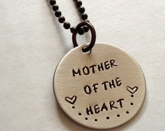 Adoption Mom Necklace Reads Mother of the Heart in Nickel Silver With Two Hearts