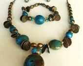 Treasure-style necklace, bracelet, & earrings set