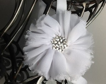 White headband:  a white shabby chic flower on a white soft headband with blingy center. Baby headband, girls headband, adult headband.