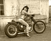 8x10 inch photo of a tattooed babe on a Triumph bobber motorcycle