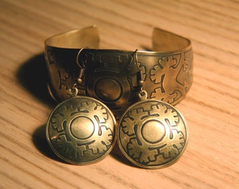 Brass bracelet and earnings with stylized sun, trees and seeds , handmade metal jewelry