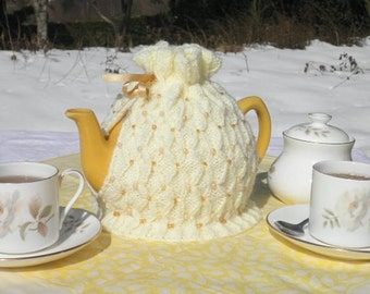 Beautiful hand knitted beaded tea cosy in a variety of colours