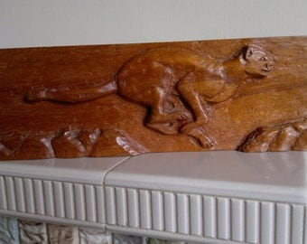 Cheetah wood carving