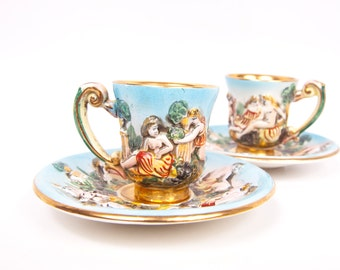 Vintage Cherub Teacups Capodimonte Italy Demitasse Set of 2 Tea Cups Saucers Raised Figural Angels Relief Pattern Grecian Figures