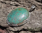 Green Spiderweb Turquoise in 52x37x10 MM Sterling Silver Pendant With Navaho Design