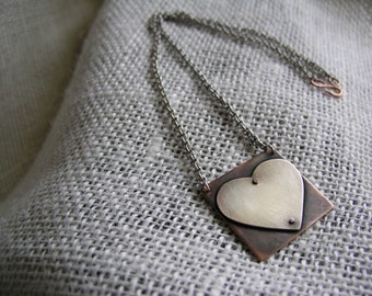 Riveted silver heart