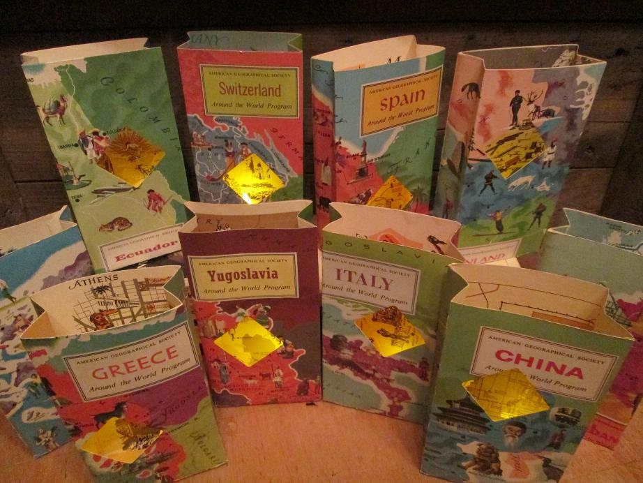 Travel centerpieces 5 travel themed travel book luminaries for Around the world party decoration ideas