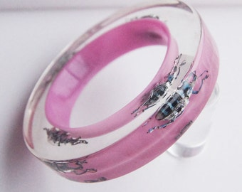Large pink lucite bangle with exotic real insects