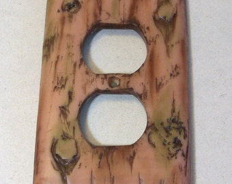 Bark of a tree light outlet cover: wood look switch plate
