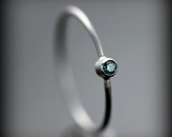Blue diamond ring - thin platinum ring with 0.03ct bezel set diamond