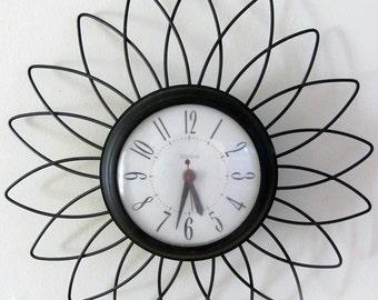 vintage 50s wall clock daisy or atom style