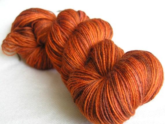 100g superwash sock yarn with nylon, ginger, orange, brown