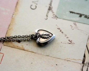 leaf locket necklace. silver ox