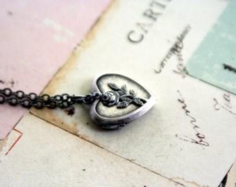 rose. locket necklace. silver ox