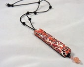 Handmade Necklace with Large Polymer Clay Focal Bead in Shades of Salmon Pink with Black