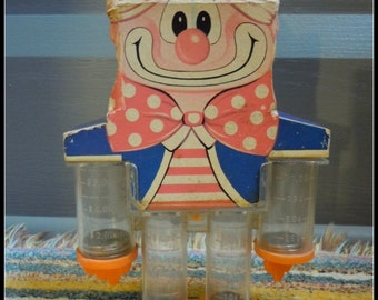 """Vintage Plastic CLOWN Coin Separator Bank from the 40's. Made in """"Hong Kong"""""""