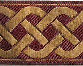 3 yards CELTIC RUNNING KNOT medium Jacquard trim in light tan on oxblood. 3/4 inch wide. 859(3)-a