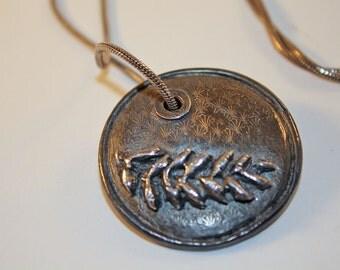 Antiqued metal clay pendant