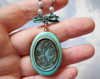 Verdigris Moss Fiddlehead fern engraved art locket on vintage soft blue pearls necklace