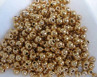 Gold Tone 3mm Beads 1000pc Metalized Plastic