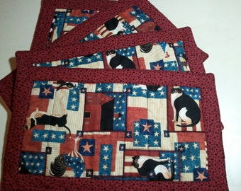 4 piece Set of Country Patriotic Quilted Place Mats in Cream, Blue, Rusty Red, Black with cows, cats, bunny, barn, stars, roosters