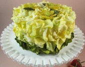 Lemon Yellow Faux Flower Petal Cake with Beaded Flowers on the Top and a Layer of Green Petals