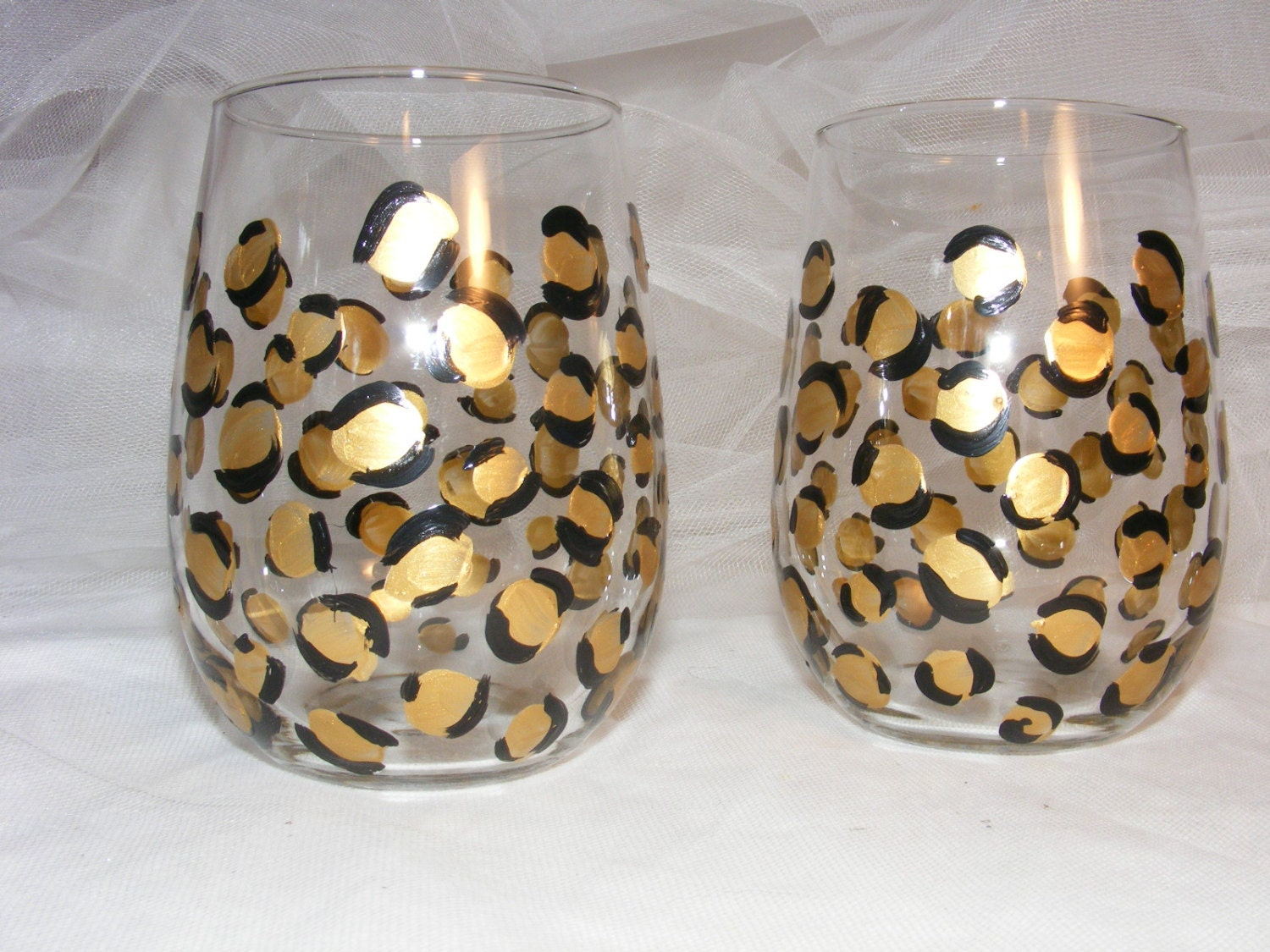 Painted stemless wine glasses in gold leopard by for Painted stemless wine glasses