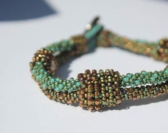 Hand Beaded Green and Bronze Kumihimo Bracelet with beaded beads and an antique Button