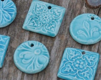 4 Turquoise Pendants or Beads