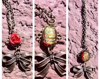 """18"""" Red & Gold Dichroic glass cabochon and bow necklace"""