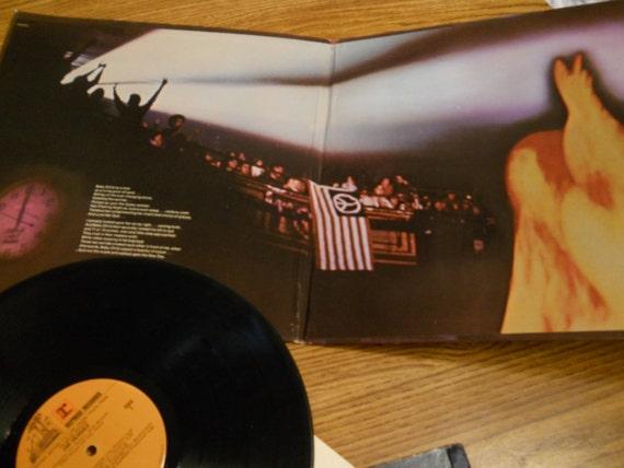 jimi hendrix band of gypsys album cover and rainbow bridge. Black Bedroom Furniture Sets. Home Design Ideas