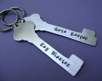 Ghostbusters Inspired Keychains - A Pair of Hand Stamped Key Master and Gate Keeper Keychains