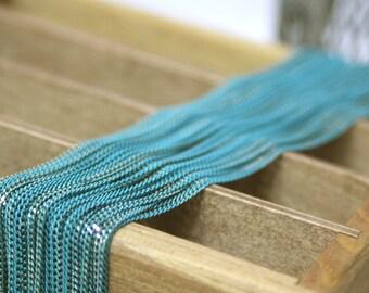 The shiny bluish green chain