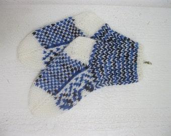 Handknitted norwegian socks in white and many shades of blue for children