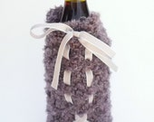 Bottle Sleeve/Cozy hand knit in textured taupe with ribbon accent great for picnics, home entertaining