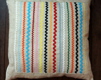 Decorative cushion made from hand woven hemp with colourful  ric rac decoration