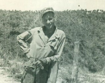 1940s Skinny Army Soldier in Uniform Leaning on a Fence Post WW2 Vintage Black and White Photo Photograph