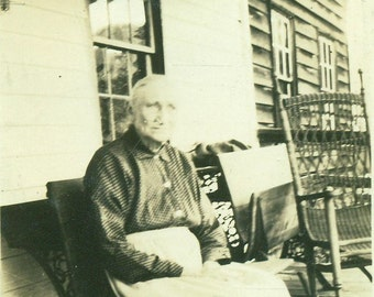 Old Farm Woman Sitting on Porch Wooden Bench Wicker Rocking Chair Apron  Black and White Vintage Photo Photograph