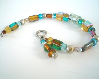 Bracelet Turquoise and Carmel cut glass beaded
