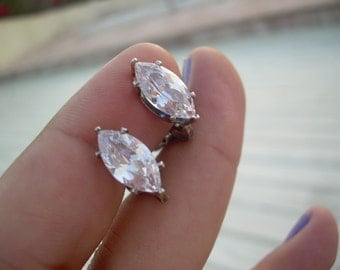 Stunning Vintage Marquis cut Diamond like stone set in a unmarked silver Material These have a Brilliant Sparkle