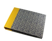 blue photoalbum with yellow spine wax batik pattern